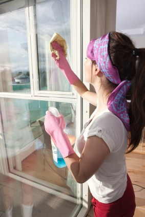 Window cleaning in Lawrence by Viviane's Cleaning & Restoration Inc - women cleaning window